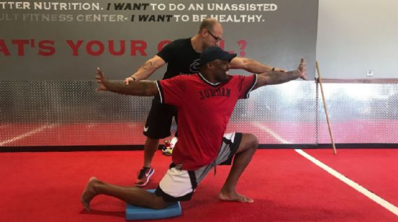 Movement training coach Shawn Myszka works with Griffen. Courtney Cronin/ESPN